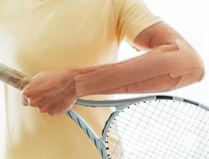 Apply KT tape for tennis elbow